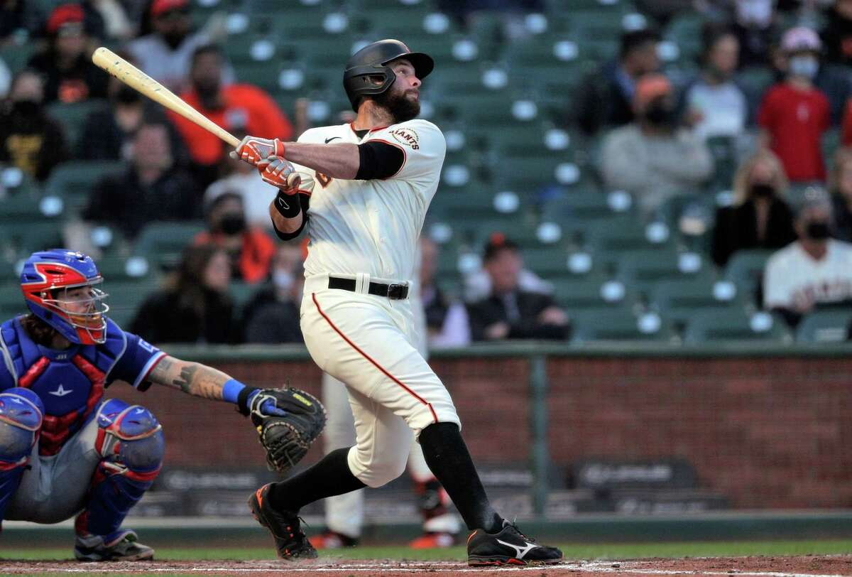 Brandon Belt (9) watches his solo homerun in the fourth inning as the San Francisco Giants played the Texas Rangers at Oracle Park in San Francisco, Calif., on Monday, May 10, 2021.