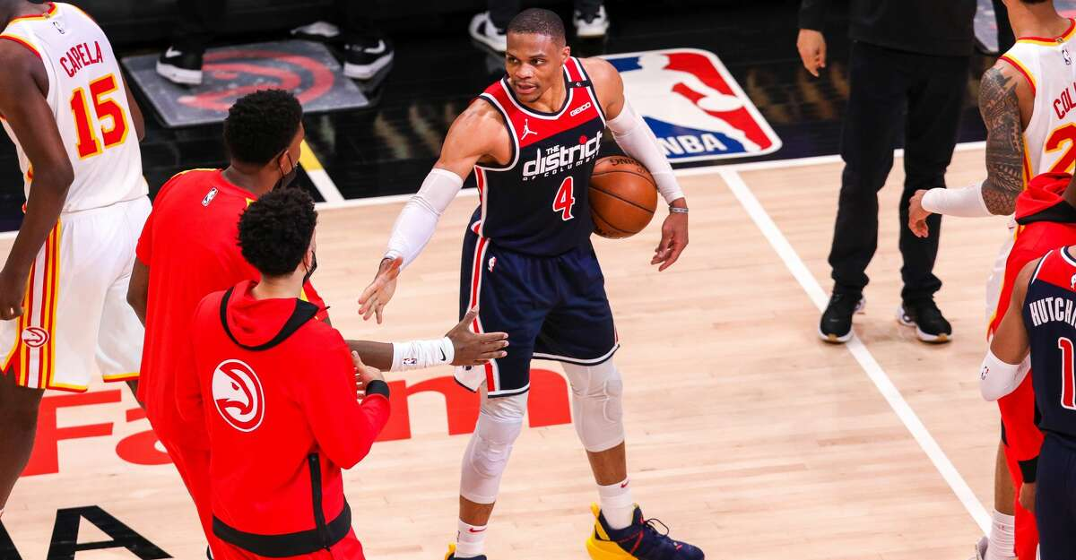 Russell Westbrook #4 of the Washington Wizards is congratulated by Atlanta Hawks players after breaking the NBA career triple-double record in a game between the Washington Wizards and the Atlanta Hawks at State Farm Arena on May 10, 2021 in Atlanta, Georgia. (Photo by Casey Sykes/Getty Images)