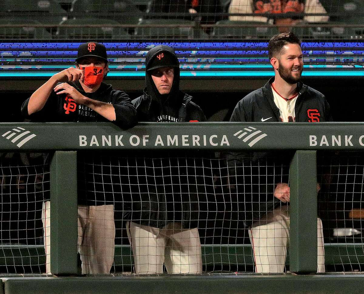 Alex Wood (57) smiles from the dugout after Maurico Dubon's (1) hit gave the Giants the lead in the seventh inning as the San Francisco Giants played the Texas Rangers at Oracle Park in San Francisco, Calif., on Monday, May 10, 2021.