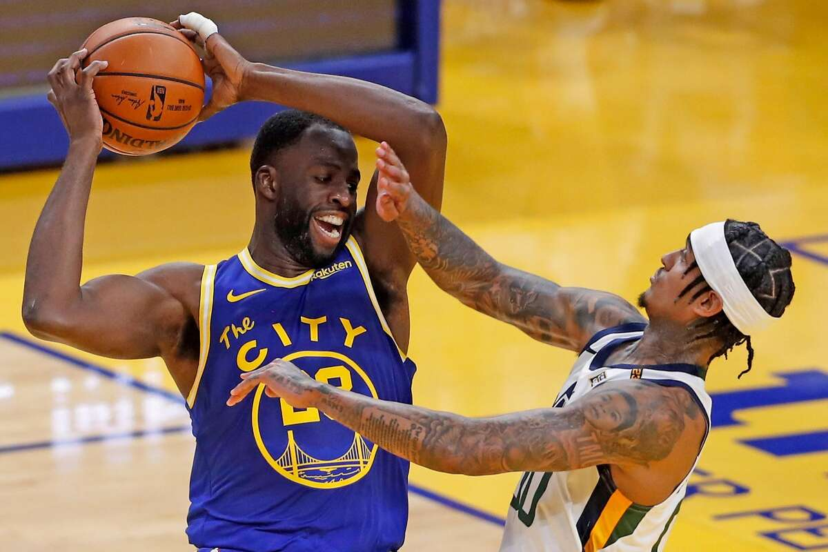 Golden State Warriors' Draymond Green is fouled by Utah Jazz' Jordan Clarkson during 2nd quarter of NBA game at Chase Center in San Francisco, Calif., on Monday, May 10, 2021.
