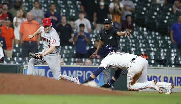Houston Astros Yuli Gurriel (10) is tagged out at third base by Los Angeles Angels Phil Gosselin to end the ninth inning of an MLB baseball game at Minute Maid Park, Monday, May 10, 2021, in Houston. Astros lost to the Los Angeles Angels 5-4. Photo: Karen Warren/Staff Photographer / @2021 Houston Chronicle