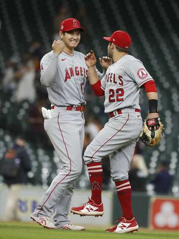 Los Angeles Angels designated hitter Shohei Ohtani (17) celebrates with David Fletcher (22) after the Angels 5-4 win over the Houston Astros during an MLB baseball game at Minute Maid Park, Monday, May 10, 2021, in Houston. Photo: Karen Warren/Staff Photographer / @2021 Houston Chronicle