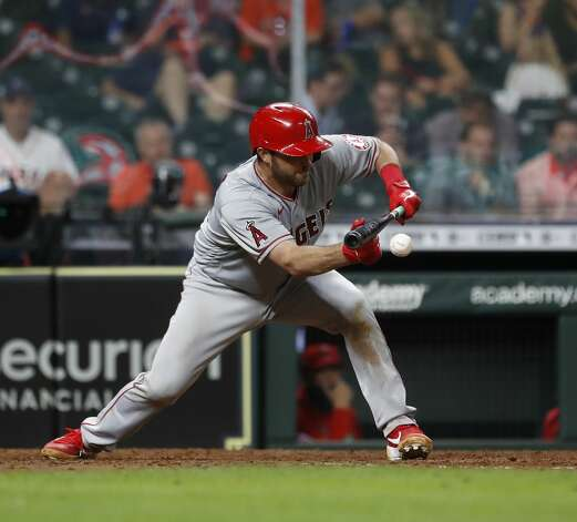 Los Angeles Angels Drew Butera bunts during the eighth inning of an MLB baseball game at Minute Maid Park, Monday, May 10, 2021, in Houston. Photo: Karen Warren/Staff Photographer / @2021 Houston Chronicle