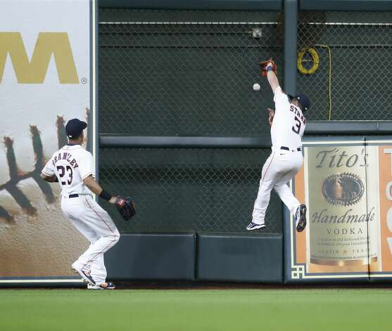 Houston Astros center fielder Myles Straw (3) jumps against the wall as he chased Los Angeles Angels Phil Gosselin's double during the eighth inning of an MLB baseball game at Minute Maid Park, Monday, May 10, 2021, in Houston. Photo: Karen Warren/Staff Photographer / @2021 Houston Chronicle