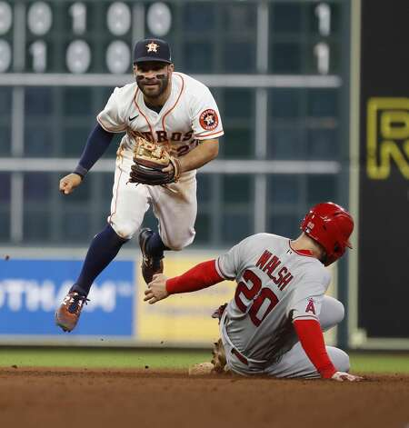Houston Astros second baseman Jose Altuve (27) tags Los Angeles Angels Jared Walsh (20) at second as Justin Upton ground into a force out during the ninth inning of an MLB baseball game at Minute Maid Park, Monday, May 10, 2021, in Houston. Photo: Karen Warren/Staff Photographer / @2021 Houston Chronicle