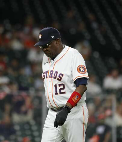 Houston Astros manager Dusty Baker Jr. (12) walks back to the dugout after a pitching change during the eighth inning of an MLB baseball game at Minute Maid Park, Monday, May 10, 2021, in Houston. Photo: Karen Warren/Staff Photographer / @2021 Houston Chronicle