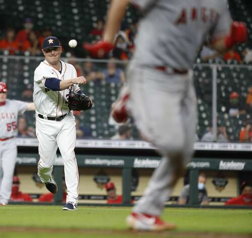 Houston Astros relief pitcher Joe Smith (38) fields Los Angeles Angels Drew Butera's sacrifice bunt during the eighth inning of an MLB baseball game at Minute Maid Park, Monday, May 10, 2021, in Houston. Photo: Karen Warren/Staff Photographer / @2021 Houston Chronicle