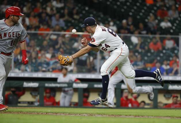 Houston Astros relief pitcher Brandon Bielak (64) tries to field Los Angeles Angels Drew Butera's sacrifice bunt during the sixth inning of an MLB baseball game at Minute Maid Park, Monday, May 10, 2021, in Houston. Photo: Karen Warren/Staff Photographer / @2021 Houston Chronicle