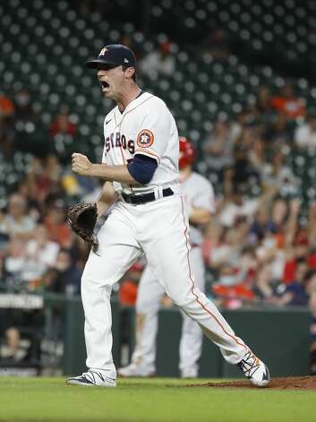 Houston Astros relief pitcher Brooks Raley (58) reacts after striking out Los Angeles Angels Taylor Ward to get out of the top of the seventh inning of an MLB baseball game at Minute Maid Park, Monday, May 10, 2021, in Houston. Photo: Karen Warren/Staff Photographer / @2021 Houston Chronicle