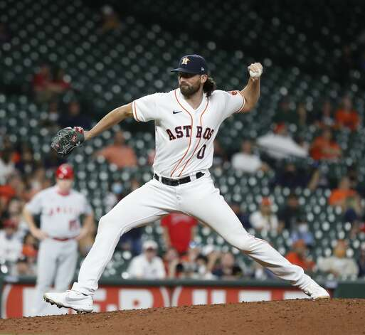 Houston Astros relief pitcher Kent Emanuel (0) pitches to Los Angeles Angels designated hitter Shohei Ohtani during the eighth inning of an MLB baseball game at Minute Maid Park, Monday, May 10, 2021, in Houston. Photo: Karen Warren/Staff Photographer / @2021 Houston Chronicle