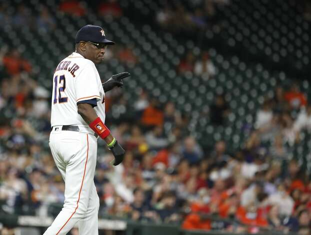 Houston Astros manager Dusty Baker Jr. (12) comes out to the mound to retrieve relief pitcher Brandon Bielak during the sixth inning of an MLB baseball game at Minute Maid Park, Monday, May 10, 2021, in Houston. Photo: Karen Warren/Staff Photographer / @2021 Houston Chronicle