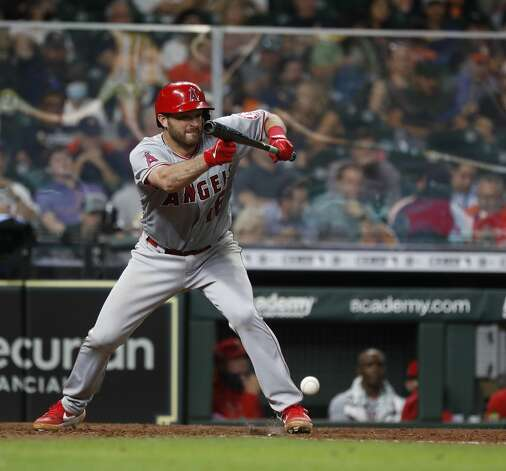 Los Angeles Angels Drew Butera (16) hits a sacrifice bunt during the sixth inning of an MLB baseball game at Minute Maid Park, Monday, May 10, 2021, in Houston. Photo: Karen Warren/Staff Photographer / @2021 Houston Chronicle