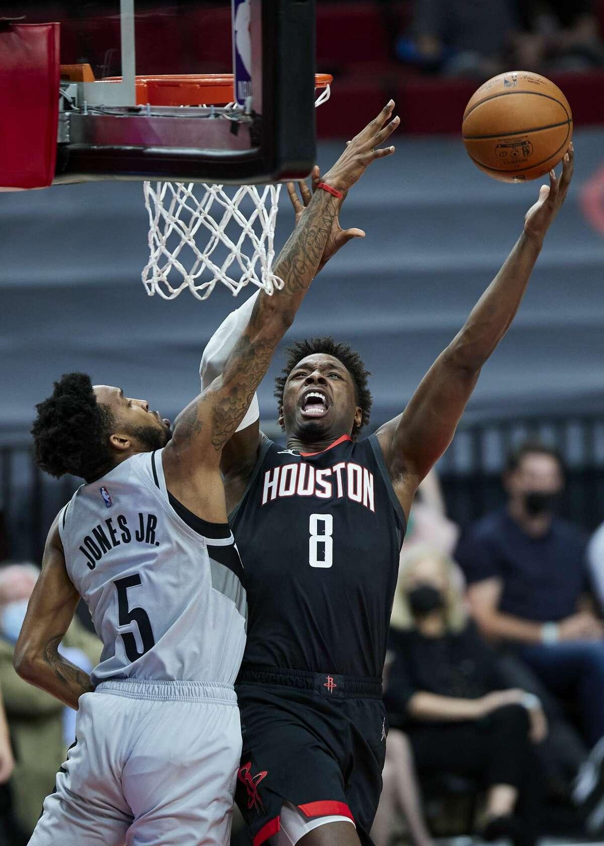 Houston Rockets forward Jae'Sean Tate, right, shoots over Portland Trail Blazers forward Derrick Jones Jr. during the first half of an NBA basketball game in Portland, Ore., Monday, May 10, 2021. (AP Photo/Craig Mitchelldyer)