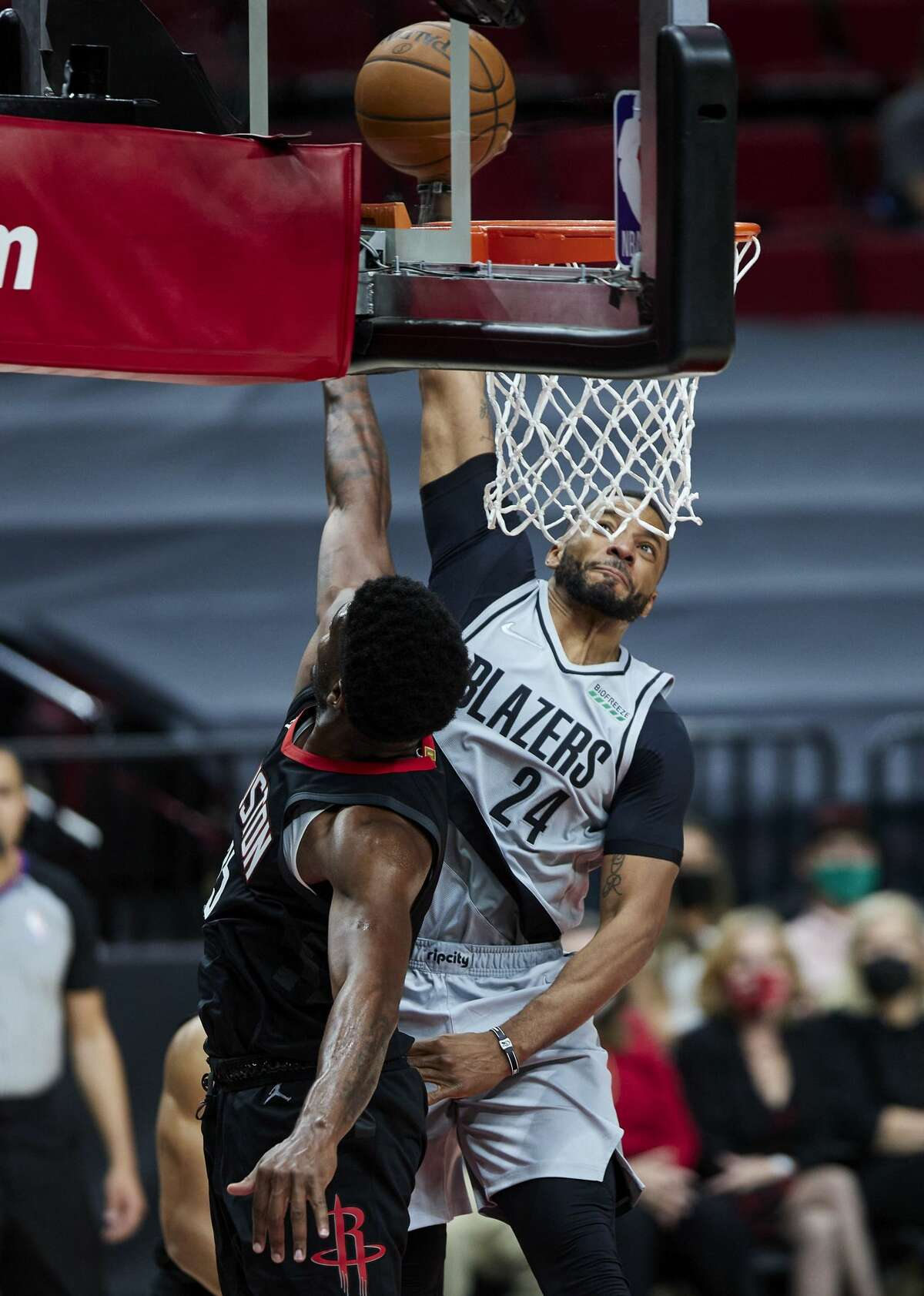 Portland Trail Blazers forward Norman Powell, right, dunks over Houston Rockets forward Cameron Oliver during the second half of an NBA basketball game in Portland, Ore., Monday, May 10, 2021. (AP Photo/Craig Mitchelldyer)