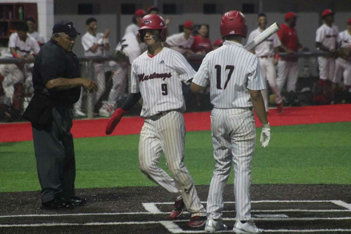 North Shore's Exavier Mendez (9) comes home on a balk call. It proved to be the score that would hand the team the bi-district crown.