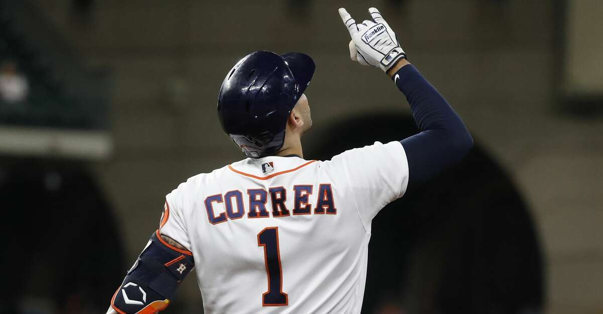 Houston Astros Carlos Correa (1) reacts after his single during the fifth inning of an MLB baseball game at Minute Maid Park, Monday, May 10, 2021, in Houston.