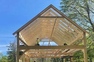 Construction of the new Shelton Trails Committee storage barn is underway. The new two-story barn replaces the red barn that was on the Shelton dog park property.