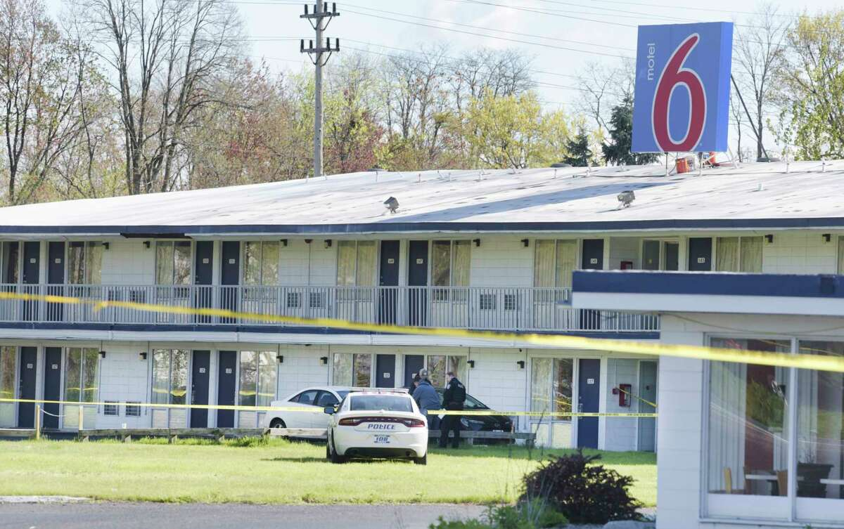 Police investigate at the scene of a Motel 6 on Tuesday, May 11, 2021, in Colonie after Xiaa Price was shot to death. A Schenectady man has been charged with murder in the case. (Paul Buckowski/Times Union)