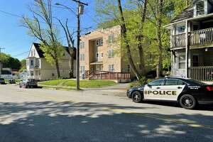 A police cruiser seen on McKinley Avenue in Norwich, Conn., on May 11, 2021, after police say a 1-month-old child was killed Monday night when he was attacked by the family dog inside their apartment (center).