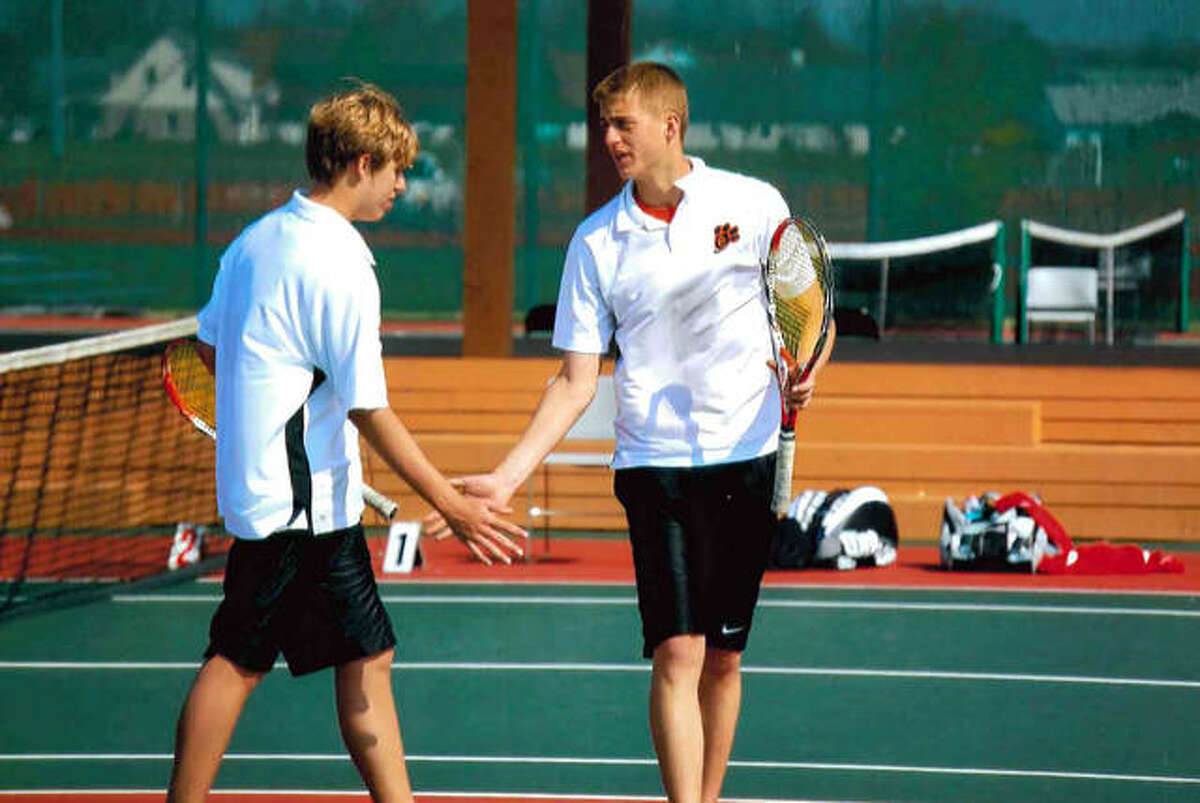 Brothers Justin Leskera, left, and Jordan Leskera celebrate a point during their days as a doubles team at Edwardsville.