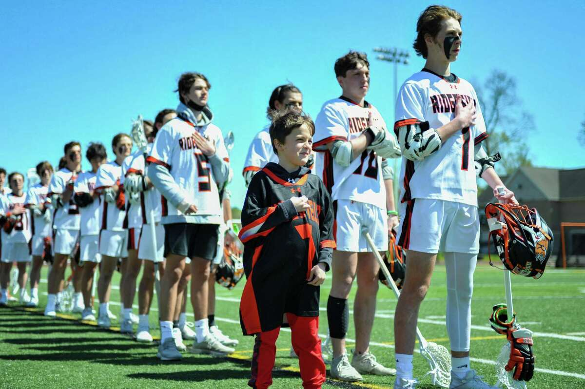 On May 1, 10-year-old Conner Curran, of Ridgefield, joined the high school boys varsity lacrosse team as their honorary captain. Since Curran has Duchenne muscular dystrophy, a muscle-wasting condition, it limits him from being able to play sports.