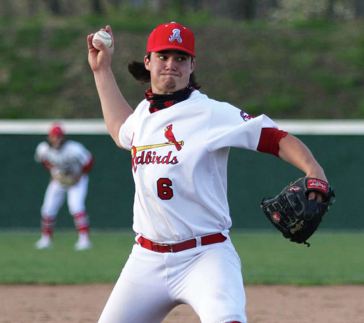 Alton's Jackson Brooks fired a two-hit shutout to beat Belleville East 1-0 in a SWC baseball game Monday at Alton High in Godfrey. The Redbirds senior is shown pitching earlier in the season.