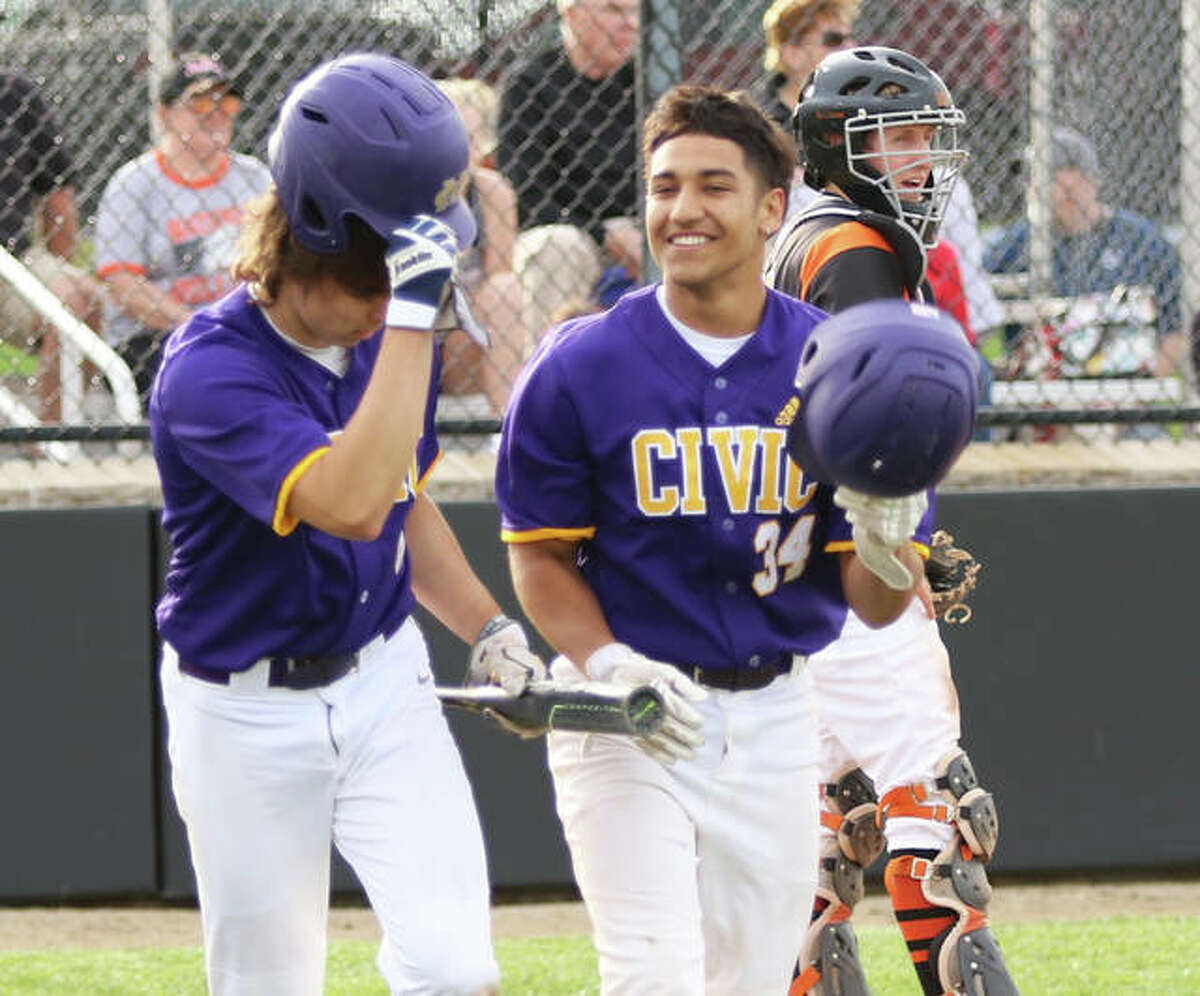 CM's Miguel Gonzalez returns to the dugout with teammate Nick Williams after Gonzalez's home run in an April 26 game at Waterloo. Gonzalez homered again Monday, providing the winning run in the Eagles' 2-1 MVC win over Jersey at the Bethalto Sports Complex.