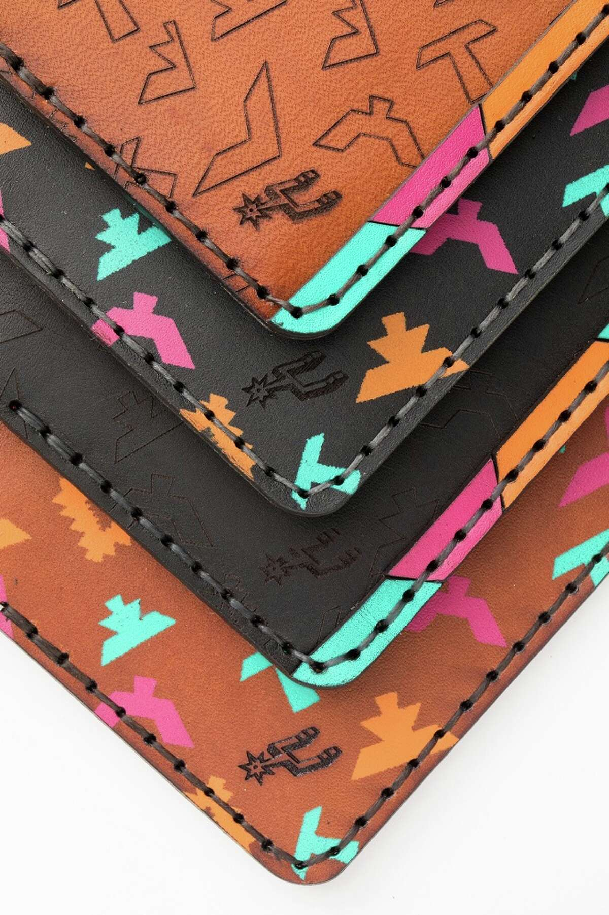 The third project between the Spurs and the San Antonio-based leather goods company is inspired by this season's City Edition jerseys. Turquoise, fuschia and orange, otherwise known as the city's signature