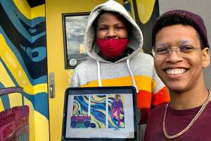 """Jade Warrick, aka """"TrashKid,"""" shows a computer image of a mural she is creating at the Troy Dance Factory with help from her brother, Arick, 13."""