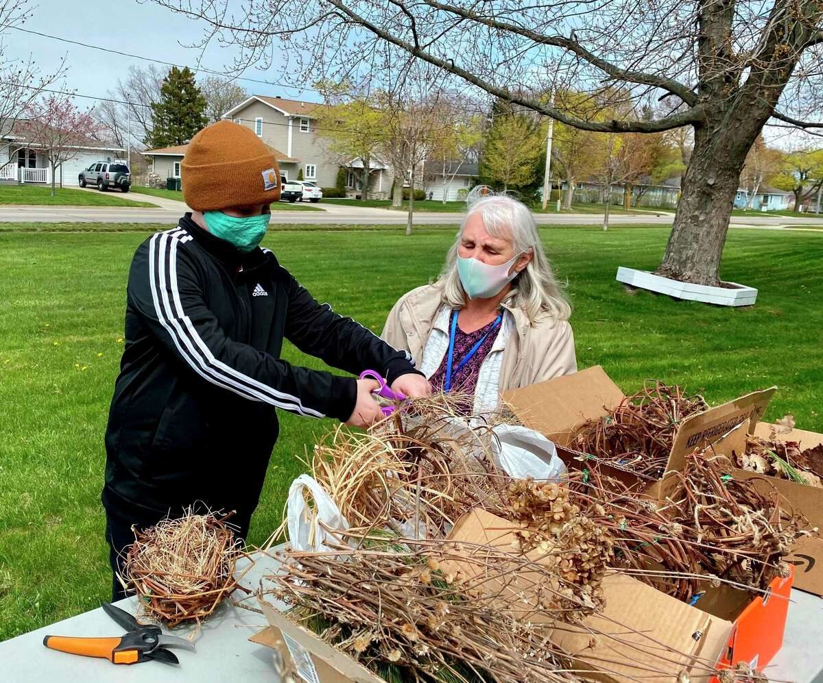 Gray Hartley and Lorraine Schwendner work on a nesting ball at theArmory Youth Project. (Courtesy photo)