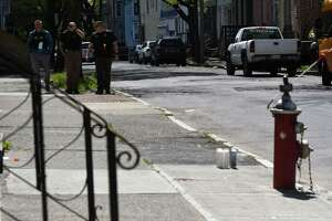 Albany police investigate the scene near 395 First Street where Danny Pearson Jr., 51, was fatally shot on Tuesday, May 11, 2021, in Albany, N.Y. The shooting happened Monday evening at about 8:20 p.m. The victim was taken to Albany Medical Center where he died, police said Tuesday. (Will Waldron/Times Union)