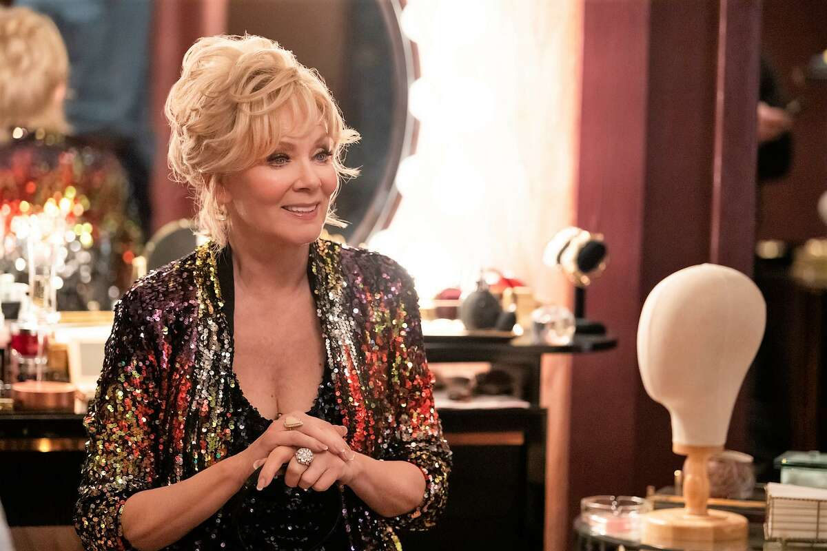 Deborah Vance (Jean Smart) doesn't spare the glamour as she readies for a stand-up performance in