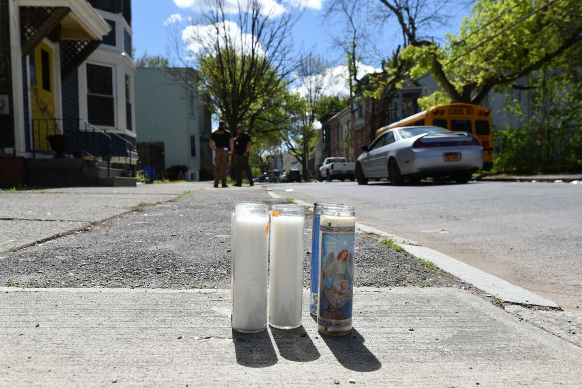 Candles are left on the sidewalk outside 395 First Street where Danny Pearson Jr., 51, was fatally shot on Tuesday, May 11, 2021, in Albany. (Will Waldron/Times Union)