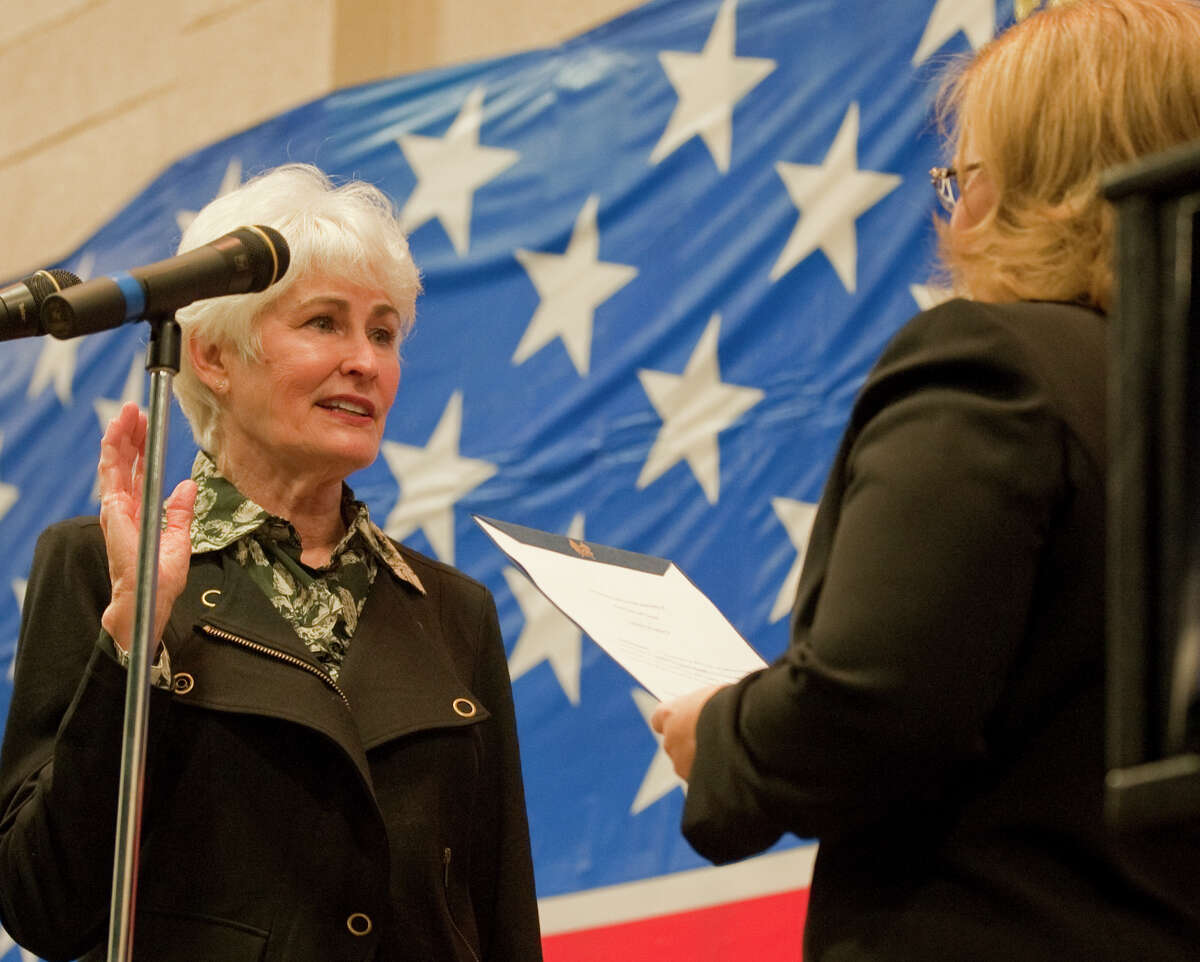 Sharla Hotchkiss takes the oath of office for city council as city secretary, Amy Turner, performs the ceremony at the Midland Center in this photo from January 2014.