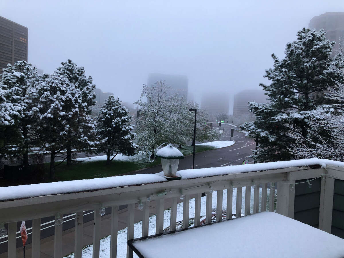 Snow falls in Denver on Tuesday, May 11, 2021.