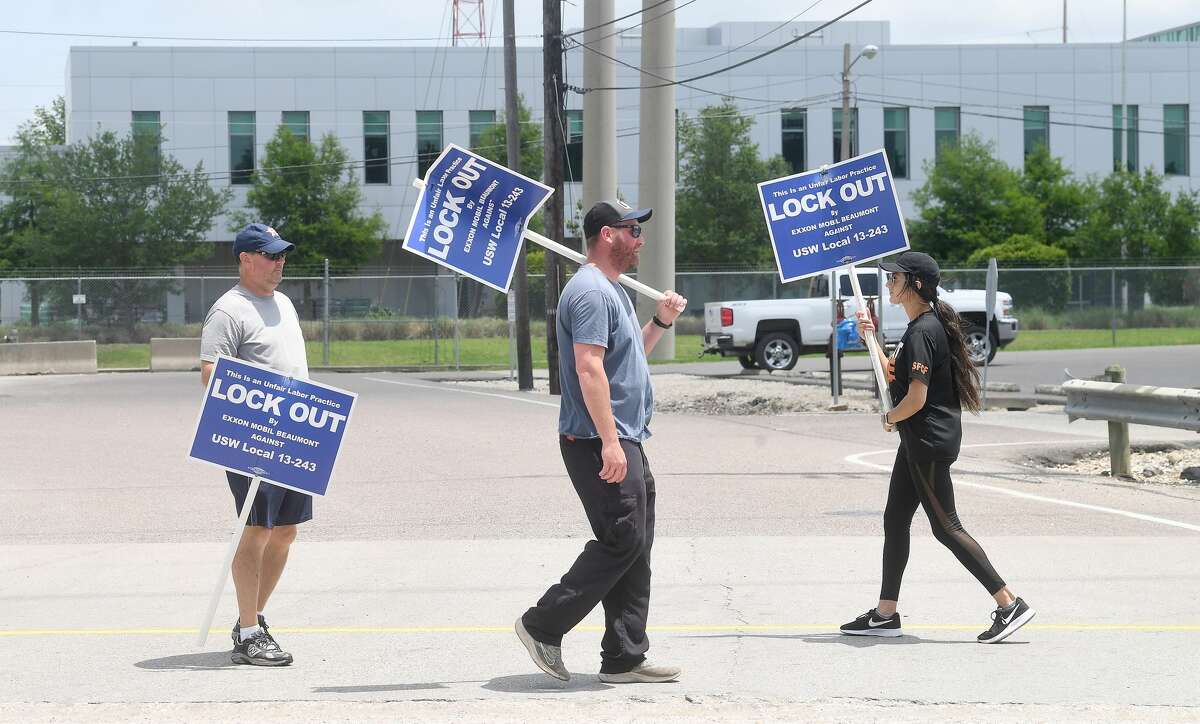 ExxonMobil hourly workers with the United Steel Workers Union, including (from left) Craig Price, Trey Peters and Gina Vila, continue their 4-hour picket shift outside the Beaumont plant Monday, May 10. Photo made Monday, May 10, 2021 Kim Brent/The Enterprise