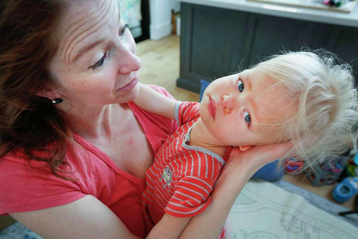 Hannah Corman holds her son Austin Thursday, April 15, 2021, in Houston.