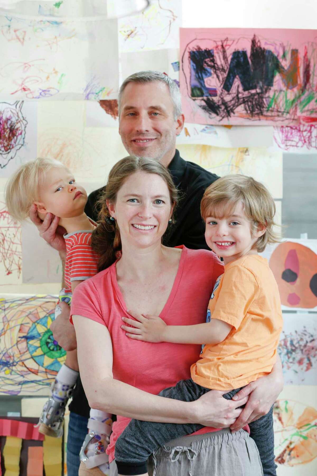 Mark Corman and Hannah Lowe pose with sons Ean, right, and Austin, who has a rare form of muscular dystrophy.