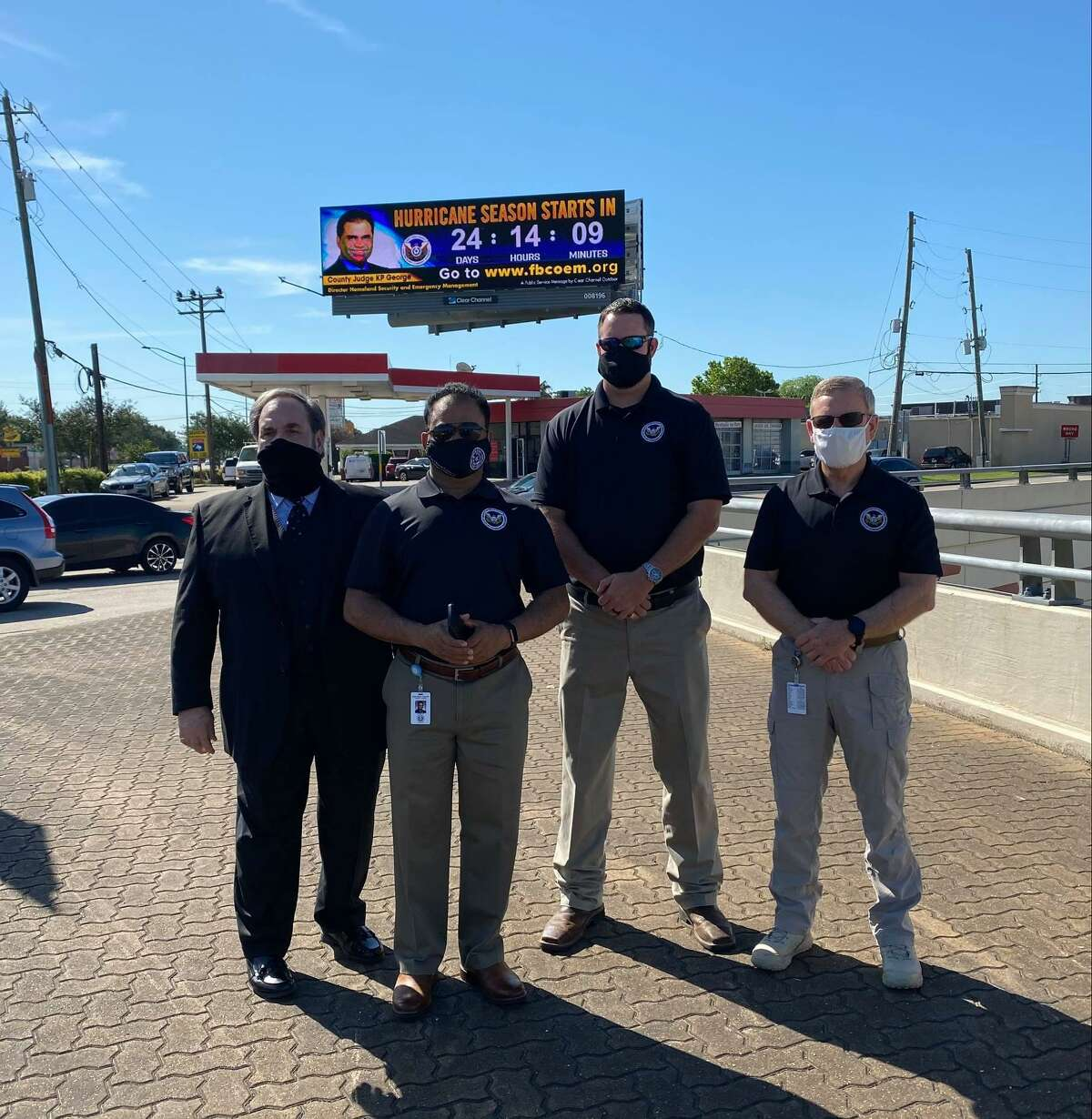 Pictured from left are Lee Vela, Clear Channel Outdoor; Fort Bend County Judge KP George; Mark Flathouse, fire marshal and emergency management coordinator at Fort Bend County; and Alan Spears, deputy emergency management coordinator at Fort Bend County.