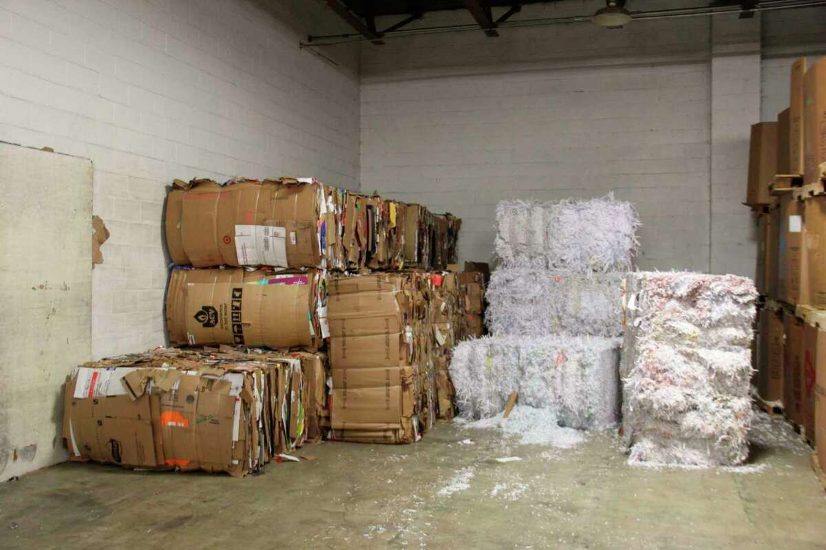 Stacks of recyclable material sit at the old Thumb Industries recycling facility in Bad Axe. The Huron County Board of Commissioners voted against a proposed ballot measure that would have started a new county-wide recycling program to replace the defunct Thumb Industries program. (Tribune File Photo)