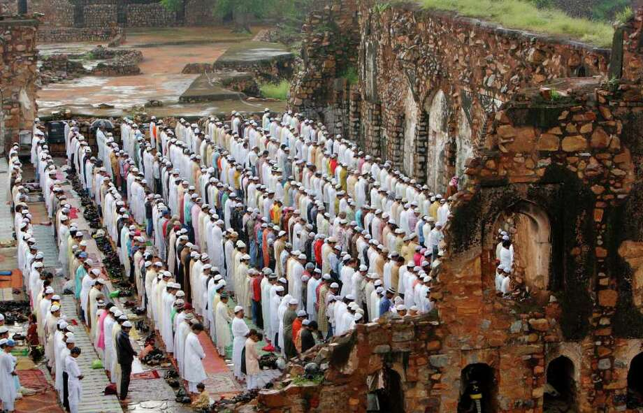 Muslims offer Eid al-Fitr prayers at the Ferozshah Kotla mosque in New Delhi, India, Saturday, Sept. 11, 2010. Eid al-Fitr festival marks the end of the Muslim holy fasting month of Ramadan. (AP Photo/Gurinder Osan) Photo: Gurinder Osan