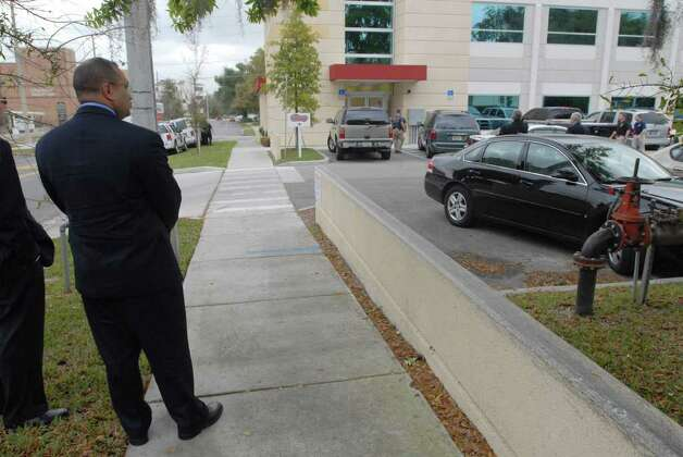 Albany County District Attorney David Soares waits on the sidewalk just outside Signature Compounding Pharmacy in Orlando, Feb. 27, 2007, as a raid of the drug company begins.  (Paul Buckowski / Times Union) Photo: Paul Buckowski / Albany Times Union