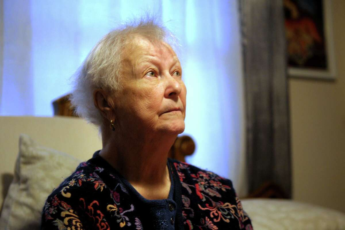 Maria Michaels poses during an interview in the bedroom where she spends most of her time in her home in Stratford, Conn. Jan. 17, 2020. Michaels, 88, is appealing a recent eviction order to vacate the home where she has lived for over 50-years.