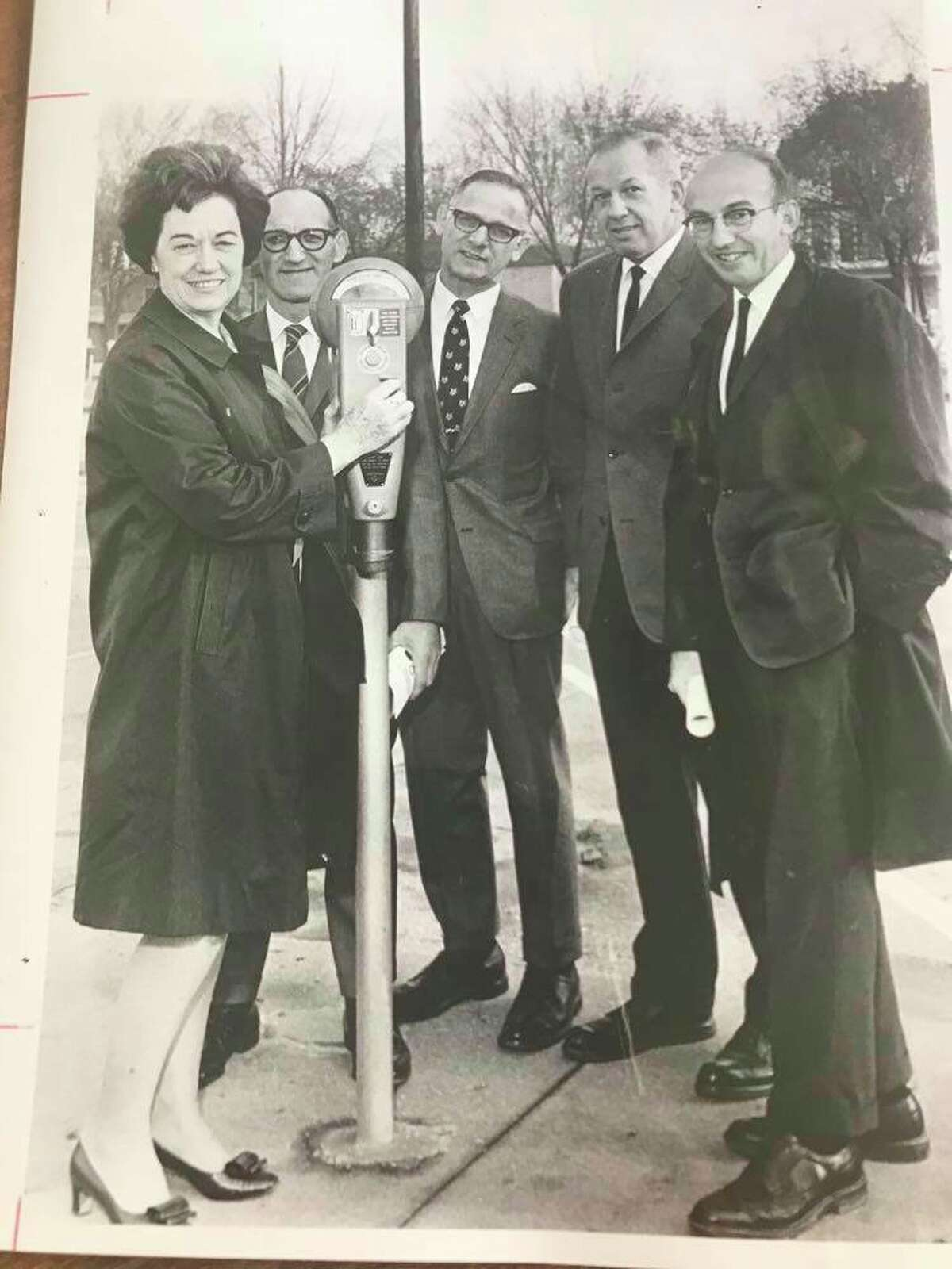Julius Grosberg, owner of Jay's Mens and Boys Wear, second from left, Marvin Stein, president of Midland Downtown Business Association, third from left, and William H. Meier, far right. Others unknown. Thank you to reader G. Thomas Snyder for updated information.