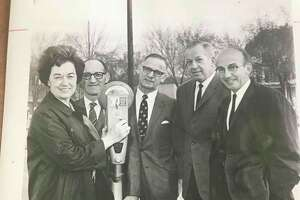 Julius Grosberg, owner of Jay's Mens and Boys Wear, second from left, and William H. Meier, far right. Others unknown