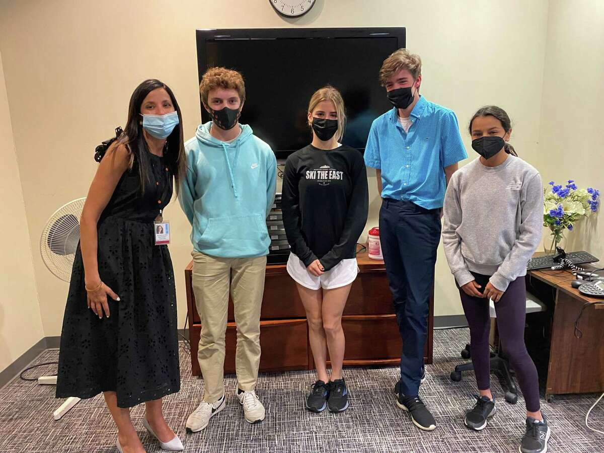 Pictured (from left to right): Superintendent Susie Da Silva with Scotts Ridge Middle School students Aidan Mignano, Dakota Smith, Lloyd Mill and Naomi Vakil.