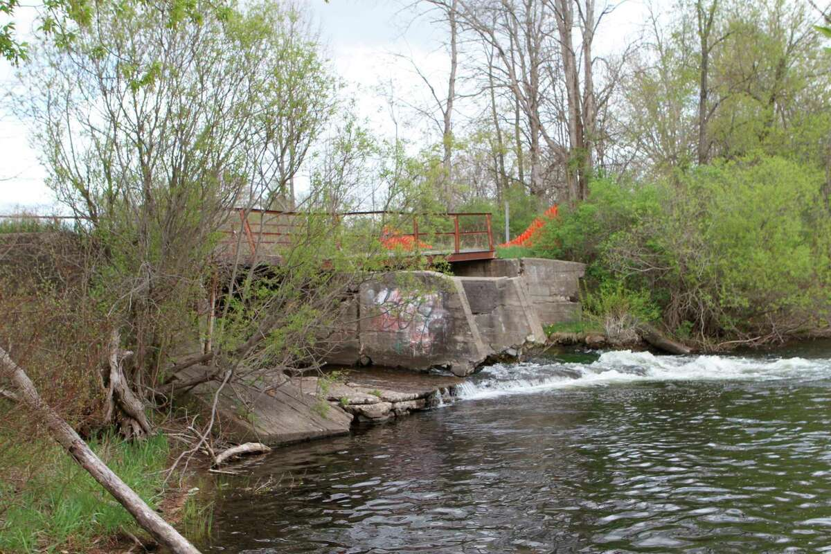 The Altona Dam has deteriorated over the years, and was built to be used for hydroelectric power for a sawmill built in the 1860s. (Pioneer photo/Olivia Fellows)
