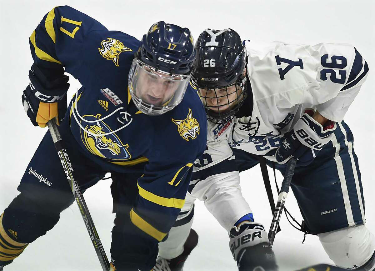 Quinnipiac's Matt Forchuck and Yale's Brett Jewell battle for position for a best-of-three first round ECAC Hockey Playoff Series, Friday, March 2, 2018, at Ingalls Rink in New Haven. Quinnipiac won, 5-1.