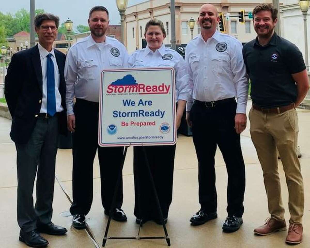 Meteorologist Kevin Deitsch of the National Weather Service, far right, recently presented a StormReady certification and sign to Madison County Chairman Kurt Prenzler, Emergency Management Agency Capt. Matthew Bogart, EMA Deputy Director Mary-Kate Brown and EMA Director Anthony Falconio.
