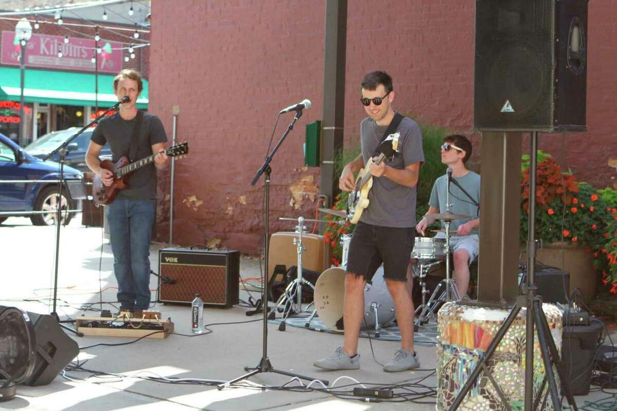 In this Aug. 8, 2020 file photo, The Balsam Brothers put on a show in downtown Big Rapids during the weekly Pocket Park Concert Series on Friday. The band will return again this year on Aug. 13. (Pioneer file photo)